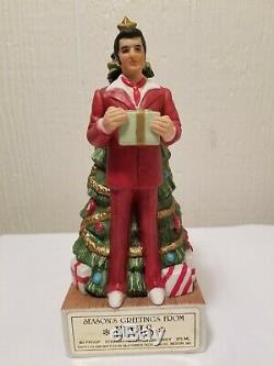 Rare Elvis Presley Christmas mini decanter and music box
